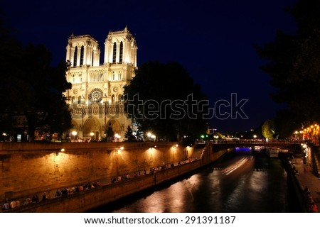 Notre Dame Cathedral night view along the Seine River, Paris, France - stock photo