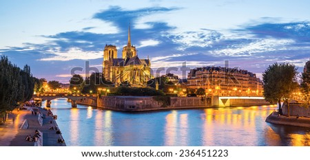Notre Dame Cathedral with Paris cityscape panorama at dusk, France - stock photo
