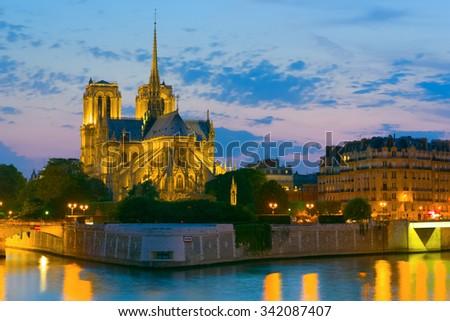 Notre Dame de Paris at a summer night - stock photo