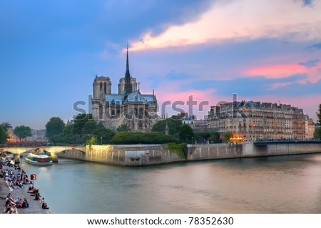 Notre Dame de Paris at dusk - stock photo
