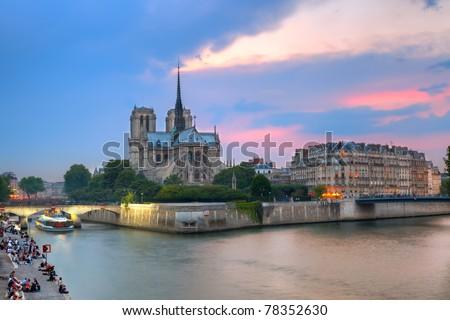 Notre Dame de Paris at dusk - stock photo
