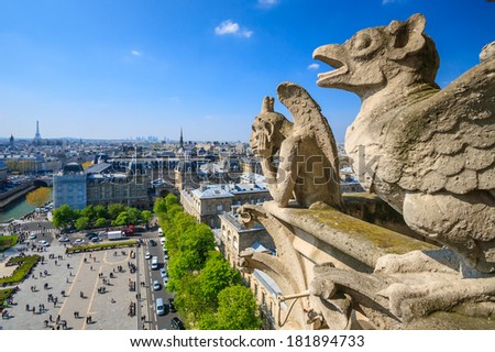 Notre Dame of Paris: Famous Chimera (demon),(gargoyle) overlooking the Eiffel Tower at a summer day - stock photo