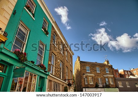 Notting Hill colorful houses at Portobello, west London - stock photo
