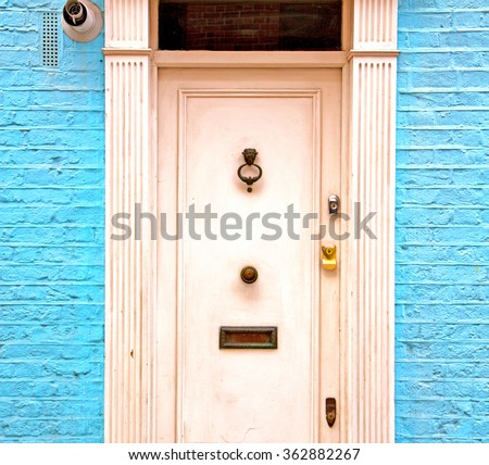 notting hill in london england old suburban and antique blue  wall door  - stock photo