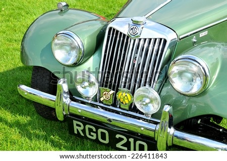 NOTTINGHAM, UK - JUNE 1, 2014: Close up of a MG (Morris Garages) vintage car for sale in Nottingham, England. - stock photo