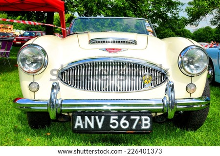 NOTTINGHAM, UK - JUNE 1, 2014: Frontal view of a white Austin Healey 3000 MkIII vintage car for sale in Nottingham, England. - stock photo