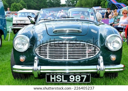 NOTTINGHAM, UK - JUNE 1, 2014: Frontal view of an Austin Healey vintage car for sale in Nottingham, England. - stock photo