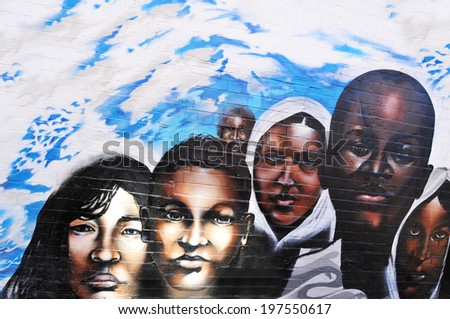 NOTTINGHAM, UK - OCTOBER 5, 2010: Urban graffiti tribute to the 17 million African children dying of malnutrition and starvation each year. - stock photo