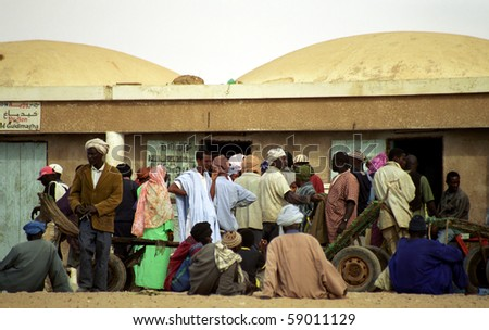 NOUAKCHOTT, MAURITANIA - JAN 5: Local people sell fish at the beach at January 5, 2006 in Nouakchott, Mauritania. Fresh fish is sold daily on the beach. - stock photo