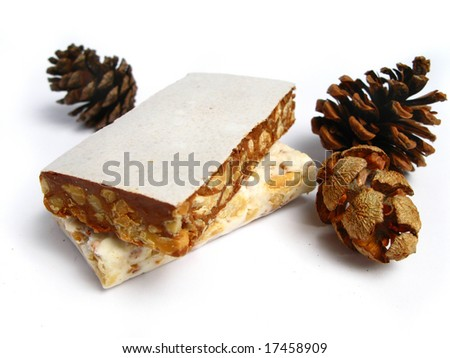 Nougat with pine cones on white background - stock photo