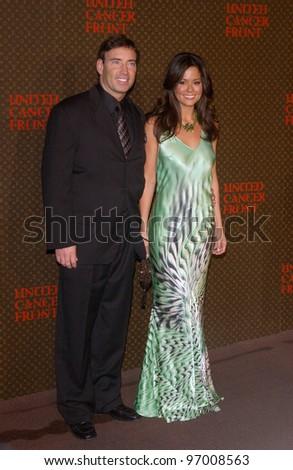 Nov 8, 2004; Los Angeles, CA; Actress BROOKE BURKE & husband GARTH FISHER at the Louis Vuitton United Cancer Front Gala at Universal Studios, California. - stock photo