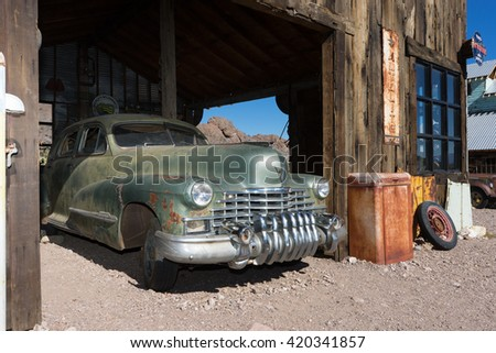 November 7, 2015 Nelson,Nevada, USA: classic collectors car parked in a vintage garage in the abandoned mining town, a popular tourist destination South of Las Vegas - stock photo