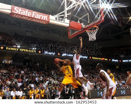 NOVEMBER 11 - PHILADELPHIA: Temple Owls guard Josh Brown (1) tries to block a shot by a Golden Flash guard during the NCAA basketball game against Kent State November 11, 2013 in Philadelphia  - stock photo