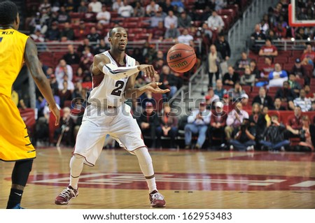 NOVEMBER 11 - PHILADELPHIA: Temple Owls guard Will Cummings (2) makes a pass during the NCAA basketball game against Kent State November 11, 2013 in Philadelphia  - stock photo