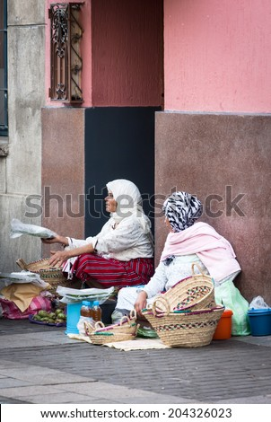 NOVEMBER 3.2013-TANGIER, MOROCCO: In the photo we see two women selling their fruits and vegetables on a street in Tangier - stock photo