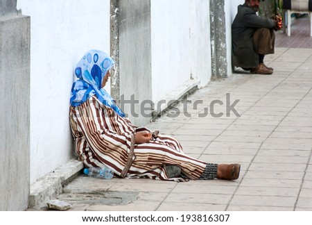 November 3,2013: Tangier, Morocco: The photo was taken around the port.A woman asking for charity - stock photo