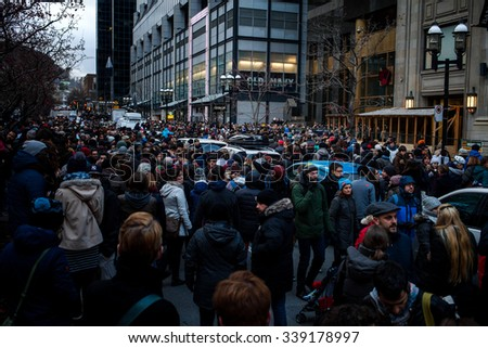 November 14th 2015, Montreal Canada. People Grouping in front of the France consulate in memory of the Jihadists ISIS Terrorist Raid in Paris - stock photo