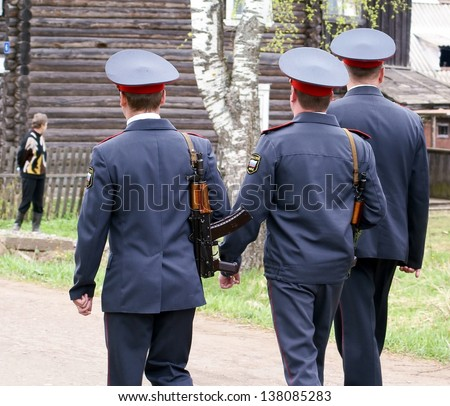 NOVGOROD REGION, RUSSIA - MAY 9: Unknown police carries raid on protection public order on streets rural settlement Bolshaya Vishera,  Novgorod region, Russia. May 9, 2010. Carried annually.  - stock photo