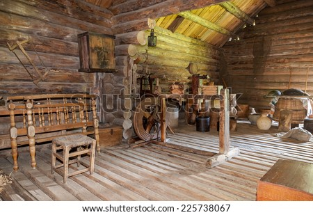 NOVGOROD, RUSSIA - JULY 23, 2014: Interior of old rural wooden house in the museum of wooden architecture Vitoslavlitsy. Wooden buildings dating from the 14th to the 19th century in museum - stock photo