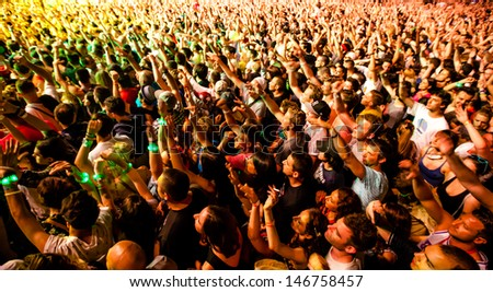 NOVI SAD, SERBIA - JULY 11: Audience in front of the Main Stage at EXIT 2013 Music Festival, during Snoop Dogg's performance on July 11, 2013 in the Petrovaradin Fortress in Novi Sad. - stock photo