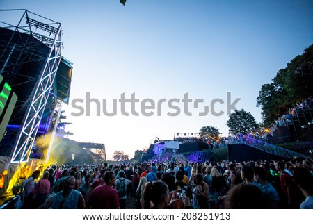 NOVI SAD, SERBIA - JULY 12: Audience infront of the Dance Arena at EXIT 2014 Music Festival, on July 12, 2014 in the Petrovaradin Fortress in Novi Sad.  - stock photo