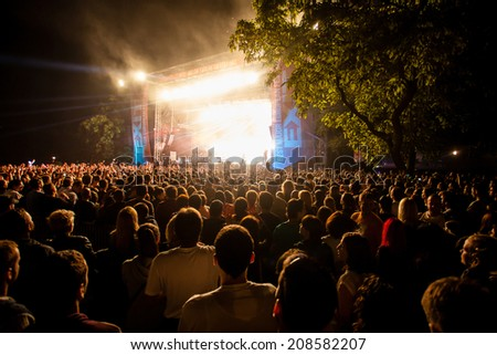 NOVI SAD, SERBIA - JULY 13: Audience infront of the Main Stage at EXIT 2014 Music Festival, during HURTS' performance, on July 13, 2014 in the Petrovaradin Fortress in Novi Sad. - stock photo