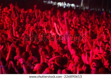 NOVI SAD, SERBIA -JULY 11: Crowd enjoying concert at Exit festival on July 11, 2014 in Petrovaradin fortress - stock photo