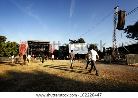 NOVI SAD, SERBIA - JULY 7: People go towards the Main Stage at the first day of EXIT 2011 Music Festival, on July 7, 2011 in the Petrovaradin Fortress in Novi Sad. - stock photo
