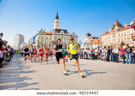 NOVI SAD, SERBIA - MAR, 25: Unidentified runners on the street during the Novi Sad spring Marathon on March 25, 2012 in Novi Sad, Srbia - stock photo