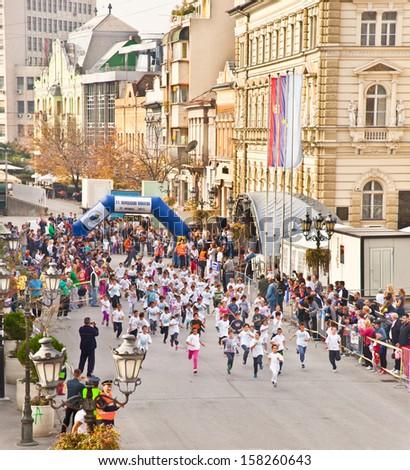 NOVI SAD, SERBIA - OCTOBER 13: Unidentified runners on the street during Novi Sad autumn Marathon on October 13, 2013 in Novi Sad, Serbia - stock photo