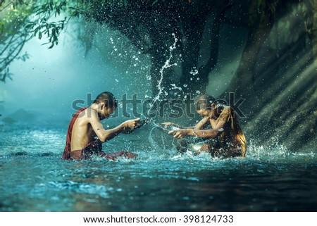 Novice buddhist monk splashing. - stock photo
