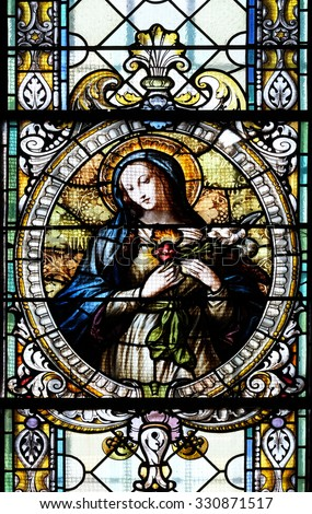 NOVO MESTO, SLOVENIA - JUNE 30: Immaculate heart of Mary, stained glass window in Cathedral of St Nicholas in Novo Mesto, Slovenia on June 30, 2015 - stock photo