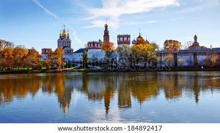Novodevichy Convent and its mirror image on the water surface, Moscow, Russia - stock photo