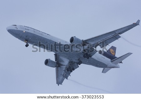 NOVOSIBIRSK - FEB. 06: D-ALCE Lufthansa Cargo McDonnell Douglas MD-11F at Novosibirsk Tolmachevo Airport. Landing during shower snow. February 06, 2016 in Novosibirsk Russia - stock photo