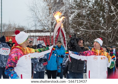 Novosibirsk, Russia - December 7, 2013 :  Passing the torch relay, in Novosibirsk - stock photo