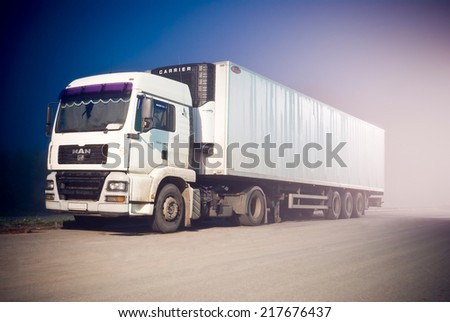 NOVOSIBIRSK, RUSSIA - JULY 28, 2014: A MAN trailer truck on a road at night. - stock photo
