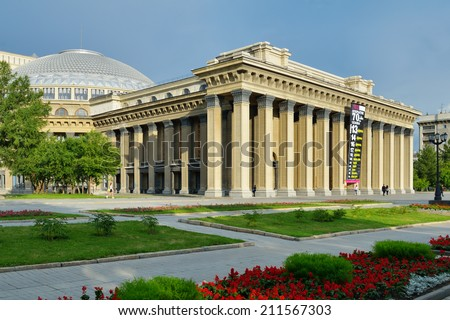 NOVOSIBIRSK, RUSSIA - JULY 30, 2014: People in front of the Novosibirsk Opera and Ballet Theater. It's the largest theatrical building in Russia - stock photo