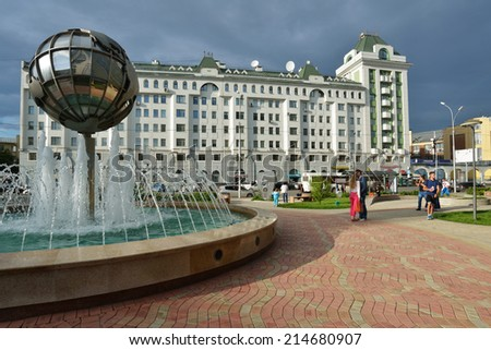NOVOSIBIRSK, RUSSIA - JULY 30, 2014: People near the fountain in the city center. Novosibirsk it the 3rd largest city in Russia by population - stock photo