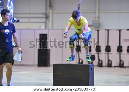 NOVOSIBIRSK, RUSSIA - NOVEMBER 16, 2014: Unidentified female athlete during the International crossfit competition Siberian Showdown. The competition is part of the festival Siberian Health. - stock photo