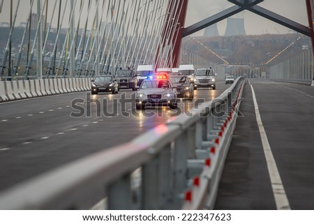 Novosibirsk, Russia - October 8, 2014: Vladimir Vladimirovich Putin (Russian President) at the opening of the third bridge in the city of Novosibirsk, presidential motorcade - stock photo