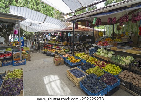 NOVYI SVIT, CRIMEA, UKRAINE - SEPTEMBER 25, 2013. Small Farmers' Market in the South European village. - stock photo
