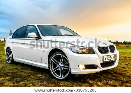 NOVYY URENGOY, RUSSIA - AUGUST 21, 2015: Motor car BMW E90 318i at the countryside. - stock photo