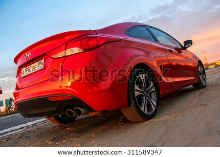 NOVYY URENGOY, RUSSIA - AUGUST 30, 2015: Motor car Hyundai Elantra Coupe at the city street. - stock photo