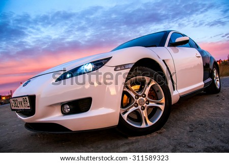 NOVYY URENGOY, RUSSIA - AUGUST 30, 2015: Motor car Mazda RX-8 at the city street. - stock photo