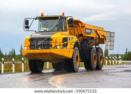 NOVYY URENGOY, RUSSIA - JULY 16, 2015: Articulated dump truck Volvo A25F at the interurban road. - stock photo