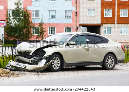 NOVYY URENGOY, RUSSIA - JULY 5, 2015: Grey motor car Nissan Teana after a heavy crash at the city street. - stock photo