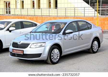 NOVYY URENGOY, RUSSIA - JUNE 1, 2014: Silver Skoda Octavia business class sedan presented at the annual Autosalon Motor show. - stock photo