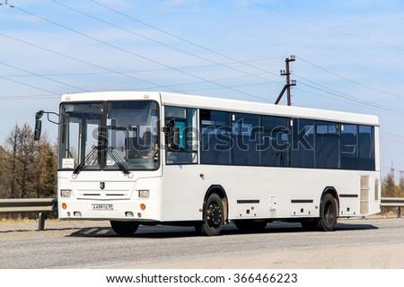 NOVYY URENGOY, RUSSIA - JUNE 12, 2013: White urban bus NefAZ 5299 in the city street. - stock photo