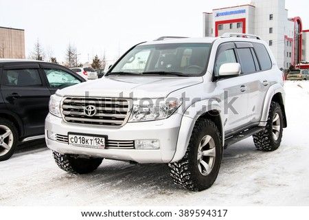 NOVYY URENGOY, RUSSIA - MARCH 9, 2016: Motor car Toyota Land Cruiser 200 customized by the Arctic Trucks company in the city street. - stock photo