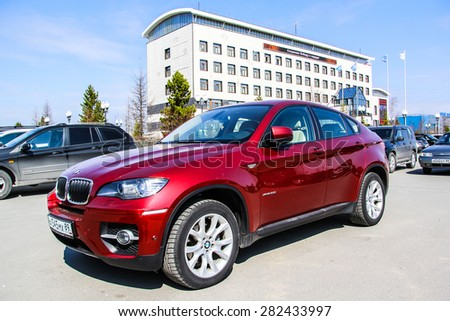 NOVYY URENGOY, RUSSIA - MAY 19, 2015: Modern cherry crossover BMW E71 X6 at the city street. - stock photo